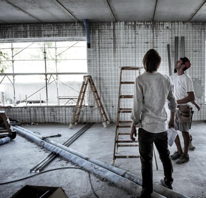 muratori al lavoro